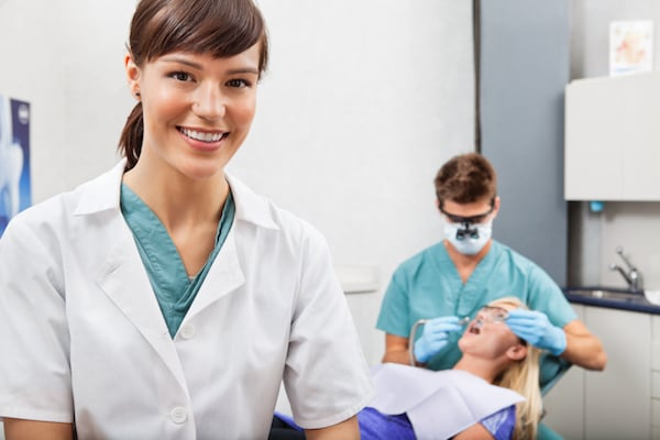 Dental assistant in an exam room